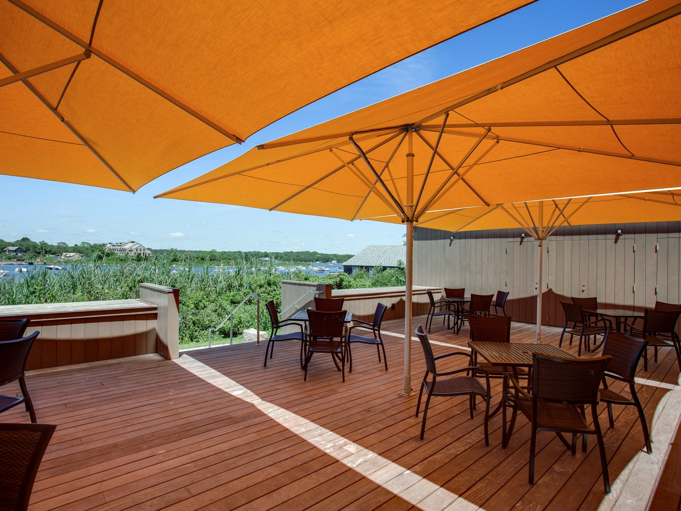 Classic Dining Drink Eat Inn Nature Outdoors Waterfront table chair floor umbrella accessory wood estate outdoor structure Resort
