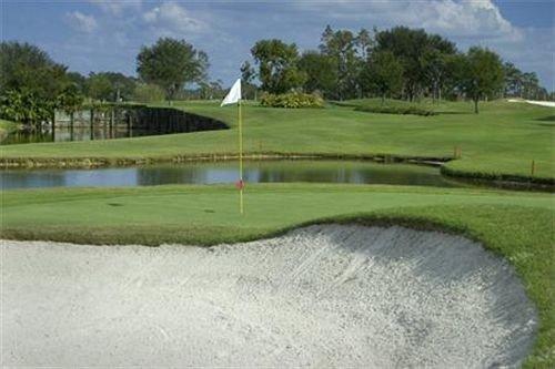 grass tree sky structure sport venue golf course Golf golf club sports outdoor recreation baseball field recreation