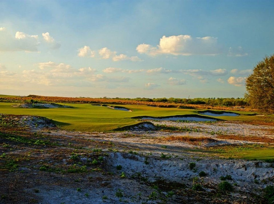 Golf Grounds Mountains Nature Outdoors Scenic views grass sky habitat field structure grassland plain natural environment ecosystem marsh wetland River sport venue prairie morning hill rural area landscape Sea grassy clouds lush highland