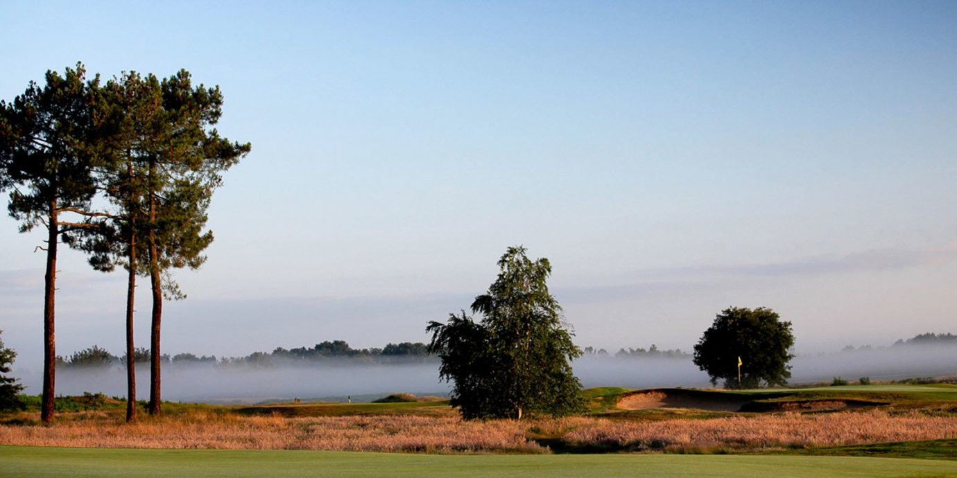 Golf Grounds Outdoors Play Scenic views grass sky Nature tree structure field grassland horizon plain cloud sport venue hill morning woody plant rural area prairie green golf course landscape golf club meadow grassy savanna plant dusk lush day