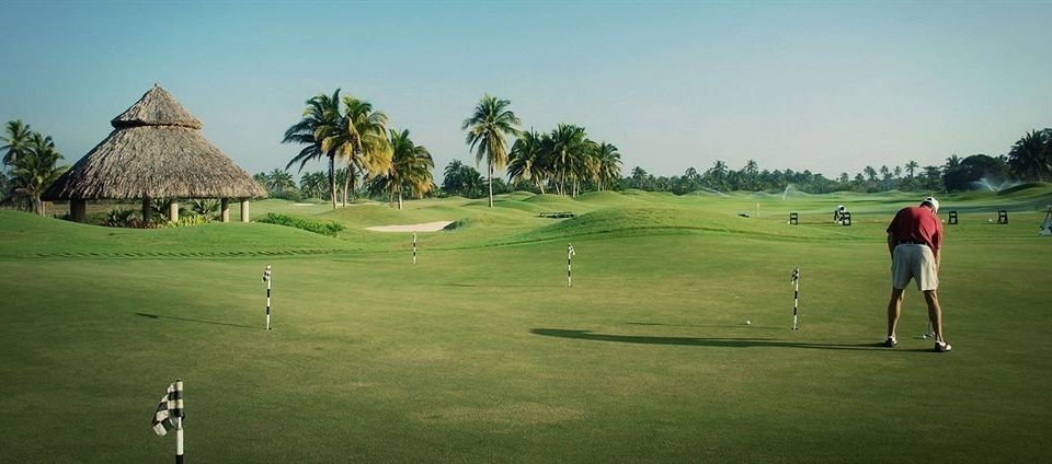 Golf Honeymoon Resort Sport Waterfront grass sky structure athletic game field sports ball game sport venue golf course pitch and putt outdoor recreation golf club recreation green grassland individual sports lush day