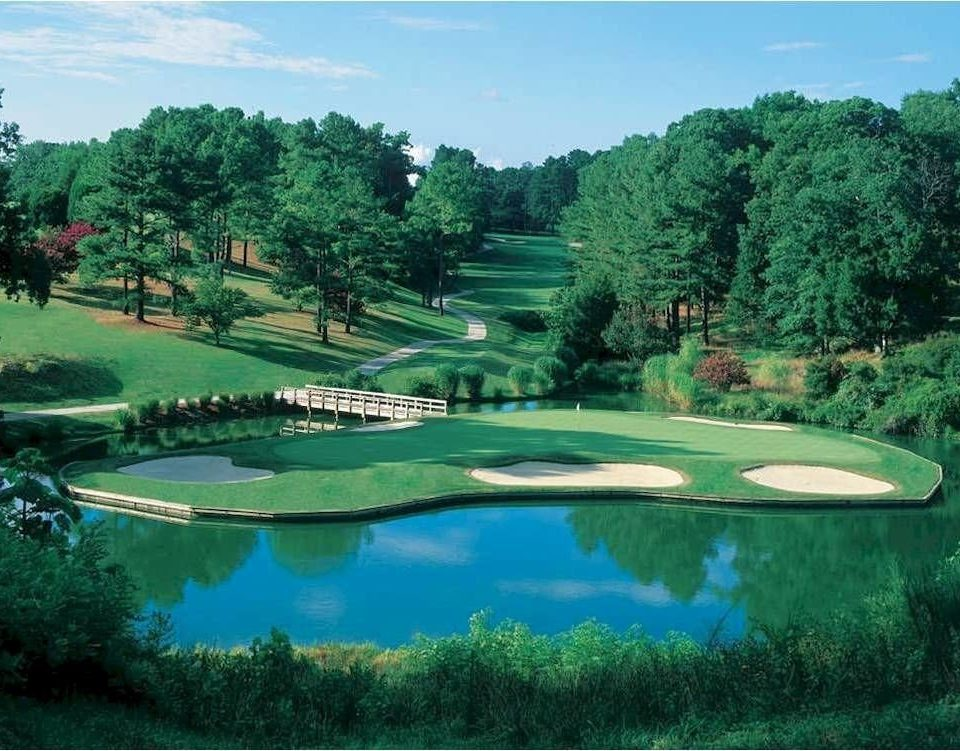 Golf tree sky green water structure sport venue golf course Nature golf club sports outdoor recreation recreation Lake surrounded wooded