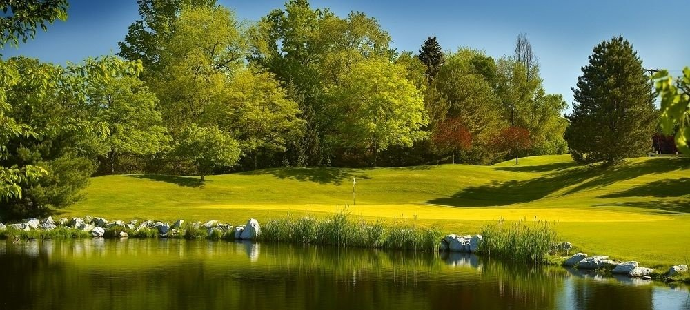 Golf Nature Outdoors Sport tree water grass sky River structure grassland sport venue golf course Lake meadow golf club lawn surrounded pond