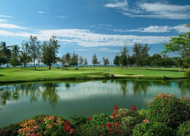 water grass sky Nature tree River Lake structure pond sport venue golf course sports golf club outdoor recreation surrounded recreation Golf overlooking lush land