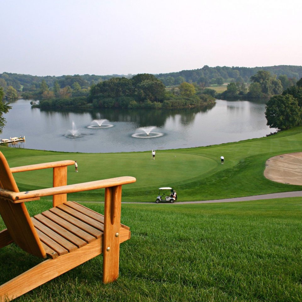 Golf Outdoor Activities Outdoors Resort Scenic views Sport Wellness grass tree sky water Lake leisure park lawn meadow overlooking chair pond seat lush surrounded