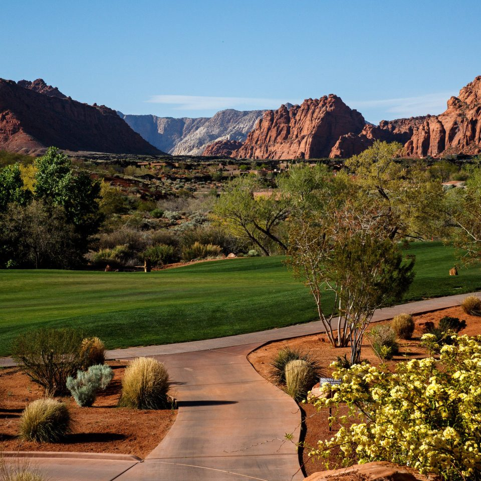 Golf Mountains Natural wonders Nature Outdoor Activities Resort Scenic views mountain sky grass valley canyon mountainous landforms wilderness tree landscape background hill outdoor recreation rural area rock recreation autumn park sports golf course hillside overlooking lush surrounded