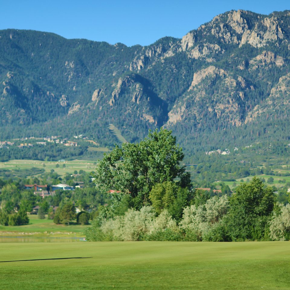 Golf Mountains Outdoors Sport mountain grass sky mountainous landforms structure sports athletic game mountain range field grassland sport venue hill outdoor recreation background recreation golf course meadow alps individual sports golf club valley plateau base lush