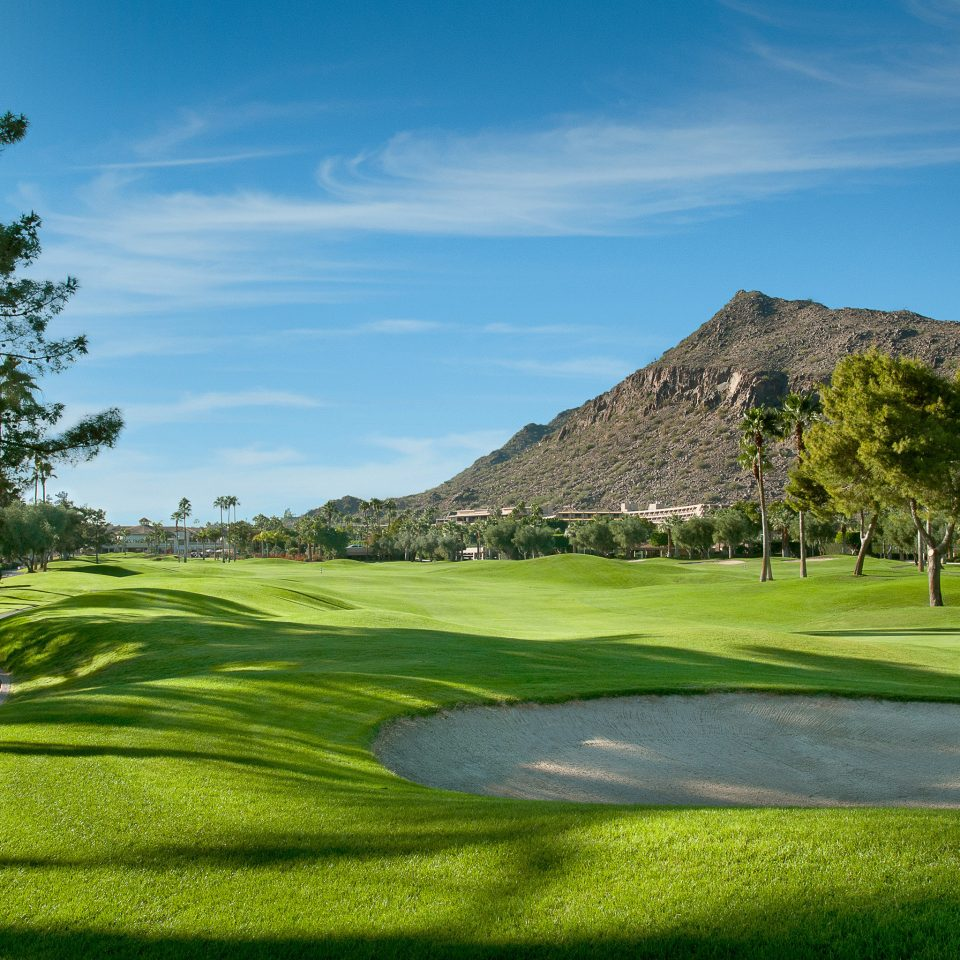 Golf Mountains Sport Wellness grass sky tree structure sport venue sports golf course grassland golf club outdoor recreation recreation lawn plant field grassy lush day