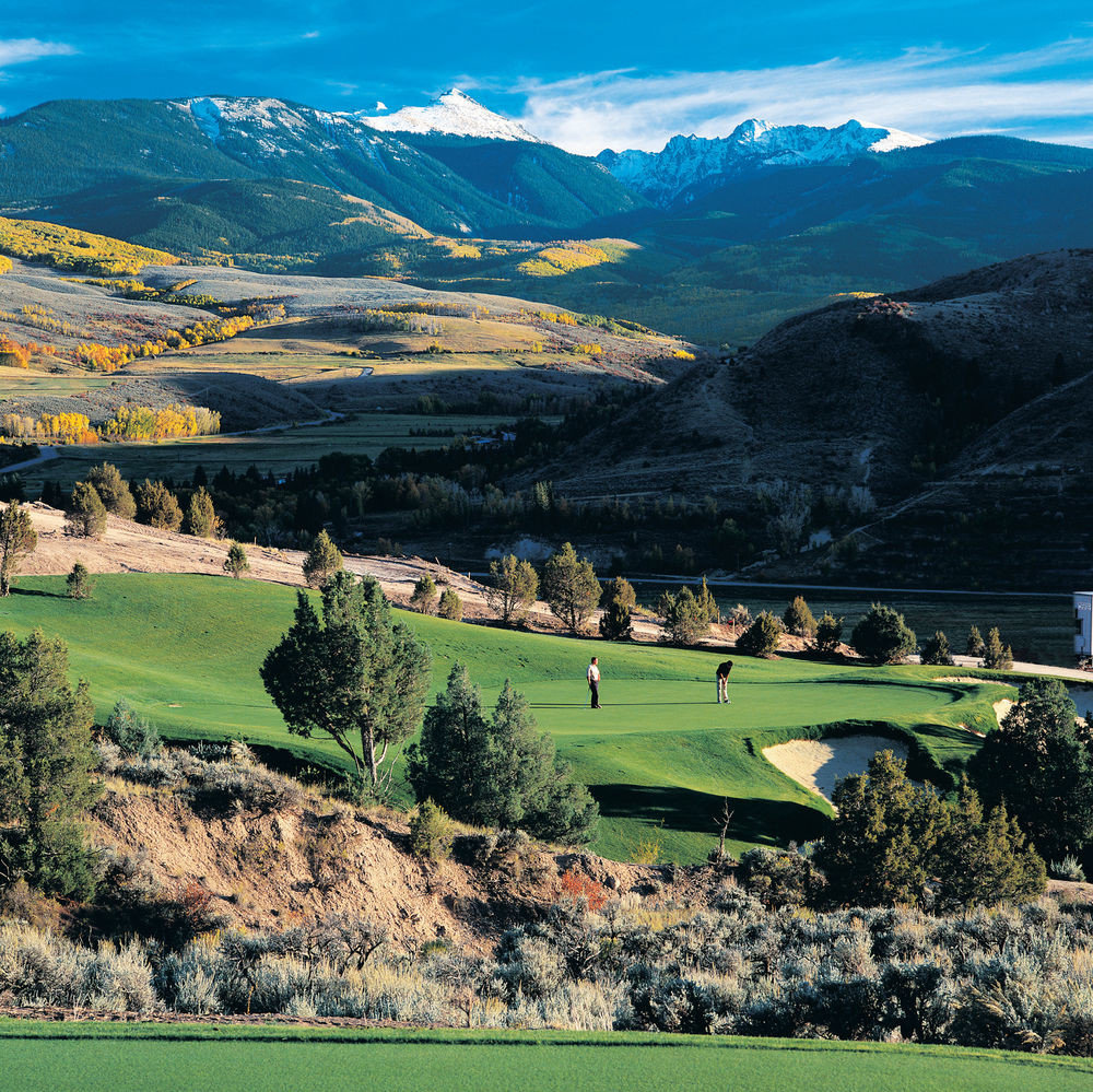 grass mountain sky mountainous landforms Nature structure field aerial photography sport venue mountain range hill golf course sports landscape rural area canyon valley Golf recreation plateau alps golf club pasture hillside overlooking lush highland