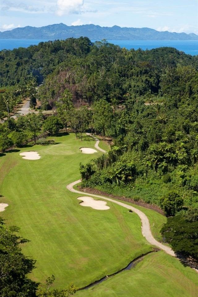 tree grass structure mountain Nature sport venue aerial photography sports green hill golf course outdoor recreation golf club rural area recreation Golf plateau meadow grassy lush plant hillside surrounded