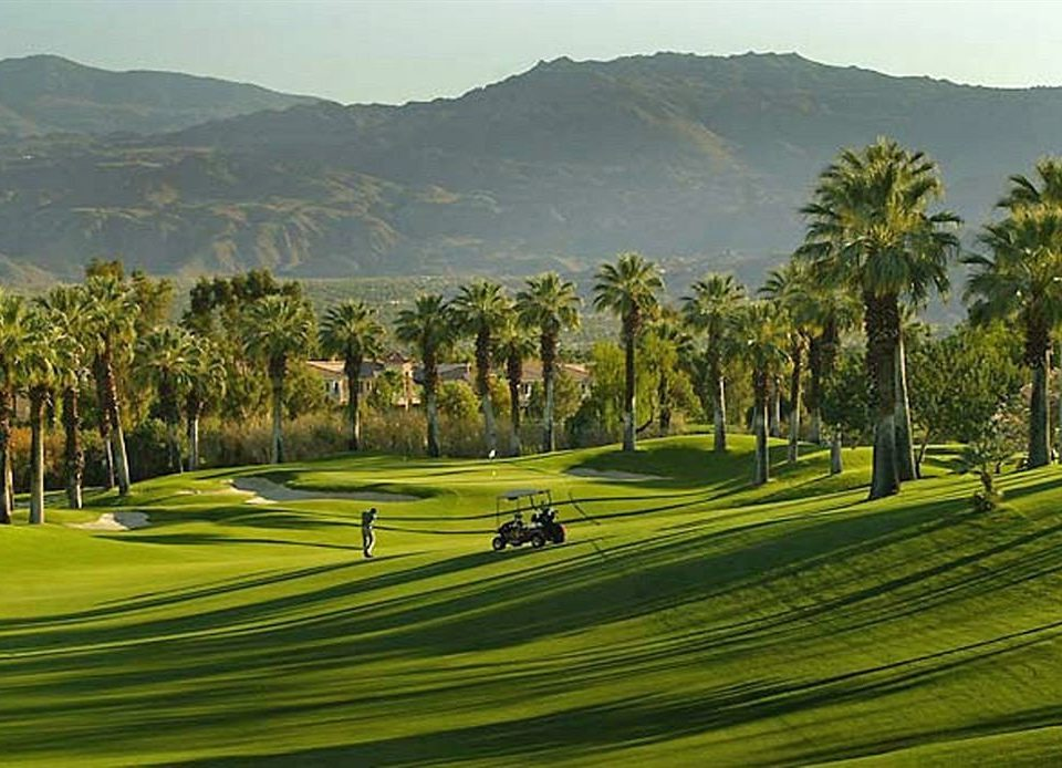 grass sky mountain structure green sport venue Golf golf course Nature golf club field hill sports outdoor recreation arecales recreation lawn plant lush