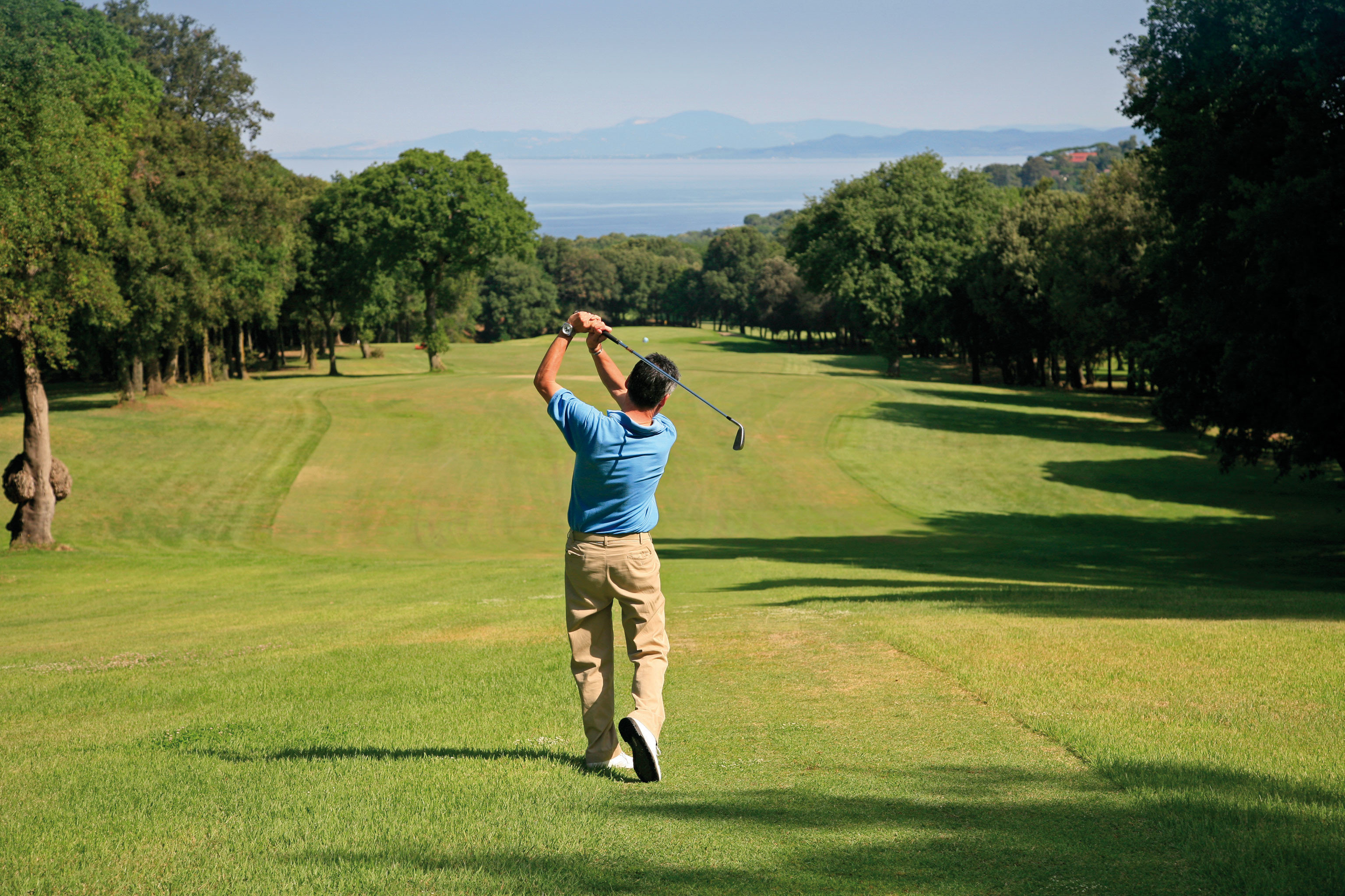 Golf Nature Outdoor Activities Outdoors Sport grass tree sky athletic game field sports structure ball game leisure pitch and putt sport venue recreation grassy outdoor recreation park golf club tournament individual sports green golf course competition event lush day arm