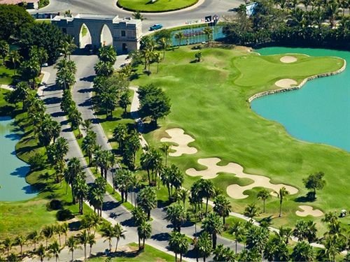 grass tree structure bird's eye view green Resort aerial photography sport venue golf course residential area golf club Golf outdoor recreation sports recreation lush hillside