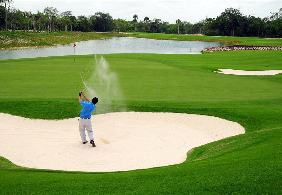 grass sky Sport athletic game structure sports Golf ball game pitch and putt sport venue baseball field field golf course golf club outdoor recreation green recreation grassland baseball park park grassy lush cement
