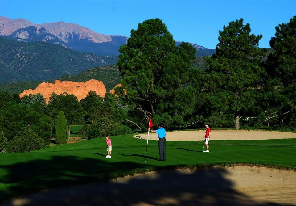 mountain tree sky structure green sports Golf Sport sport venue golf course outdoor recreation recreation golf club