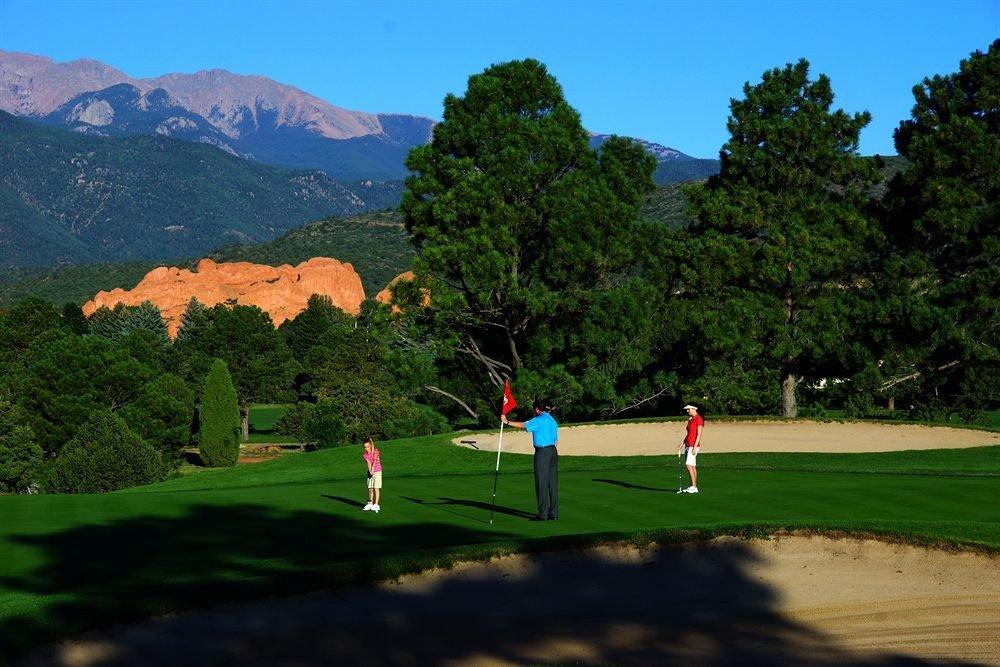 mountain tree sky structure green sports Golf Sport sport venue golf course outdoor recreation recreation golf club