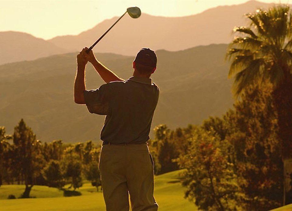 tree sky man mountain standing Golf Sport sports recreation