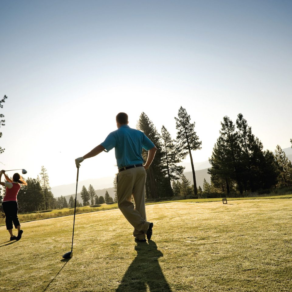 Golf Sport Wellness sky tree grass athletic game man field sports outdoor recreation recreation walking