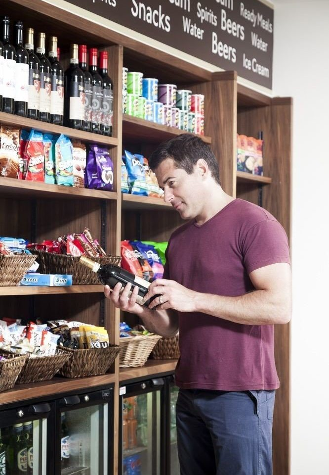 man standing shelf retail grocery store