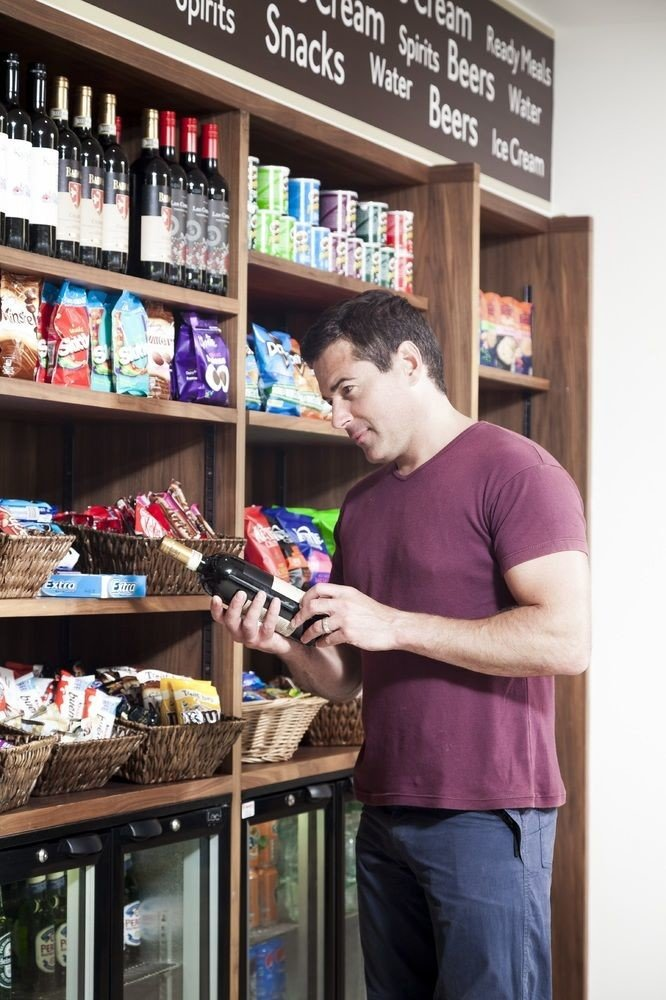 man standing shelf retail grocery store