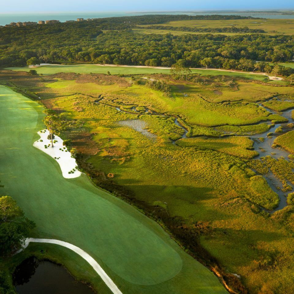 Grounds Scenic views grass sky habitat aerial photography structure plain green grassland ecosystem natural environment Nature tree hill field River sport venue wetland rural area landscape marsh lush plateau golf course reservoir Lake valley plant grassy hillside highway highland