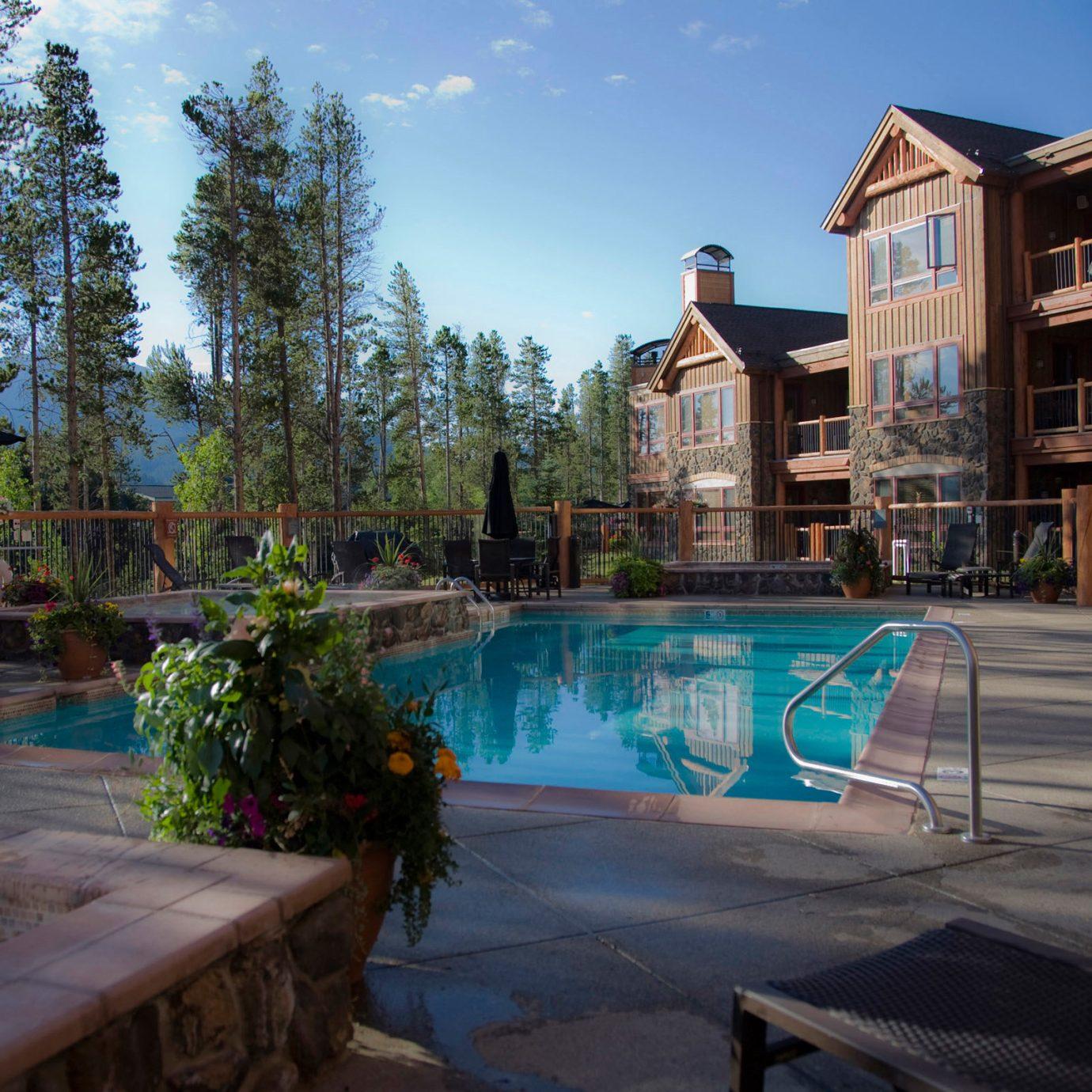 Grounds Lodge Outdoor Activities Pool Romantic Ski tree Town swimming pool Resort home plaza backyard Village walkway waterway