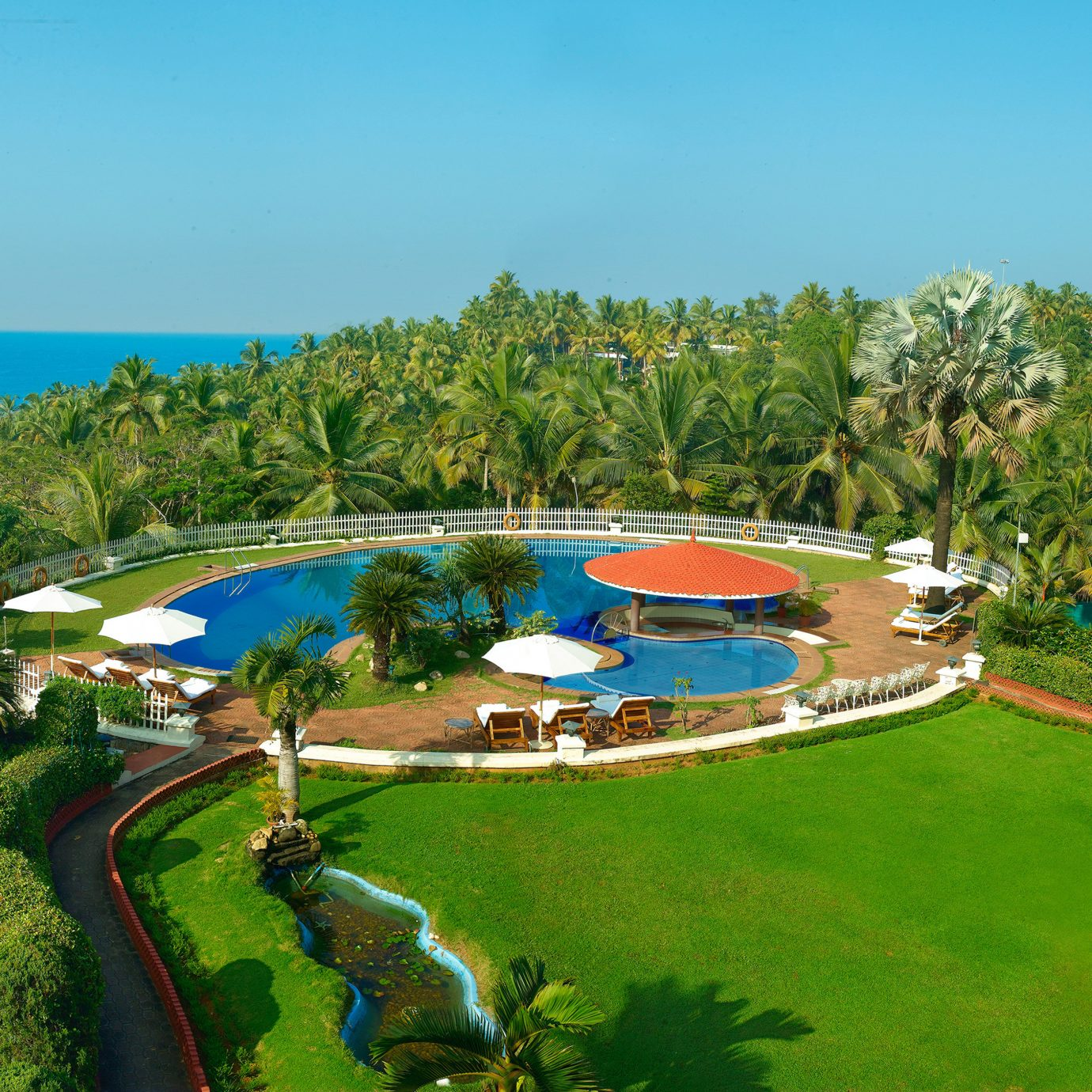 Grounds Outdoors Play Pool Resort grass tree sky leisure structure property Nature swimming pool sport venue lawn golf course aerial photography mansion park shore