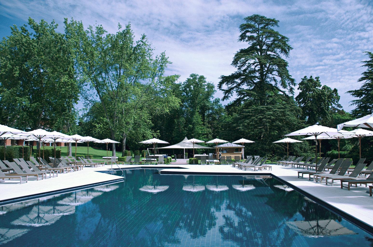 Grounds Outdoors Wellness tree swimming pool leisure property Resort resort town backyard Villa lined swimming day