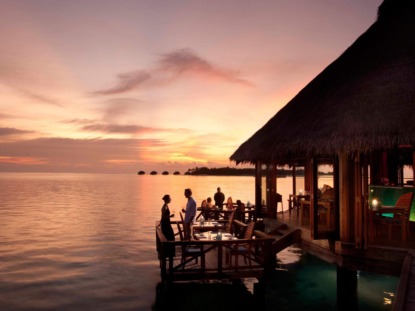 Bar Dining Drink Eat Elegant Entertainment Hotels Natural wonders Ocean Scenic views Trip Ideas Wildlife sky water outdoor Sunset Sea evening dusk morning reflection dawn bay sunrise shore