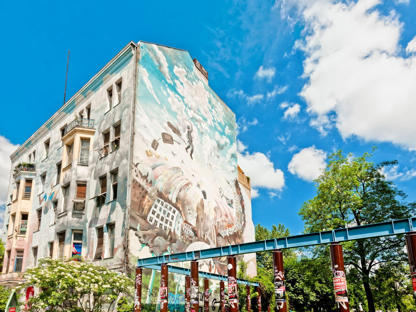 europe Trip Ideas sky outdoor landmark neighbourhood urban area Town daytime residential area metropolitan area mural tourism building tree City tourist attraction facade real estate metropolis house leisure mountain condominium mixed use