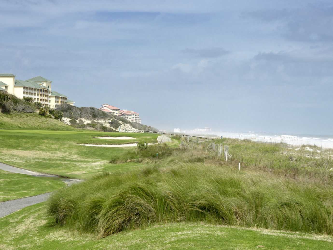 Road Trips Trip Ideas grass outdoor sky Coast promontory shore Sea terrain headland land lot Nature Beach Ocean bay grassy cloud cape grassland golf course cliff landscape grass family golf club plain hillside highland