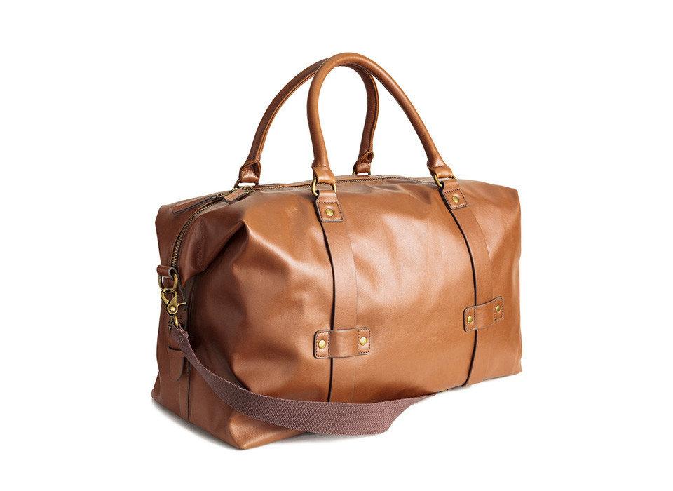 Gift Guides Travel Shop accessory luggage suitcase bag handbag brown leather fashion accessory shoulder bag caramel color piece product suit beige peach metal brand case tan
