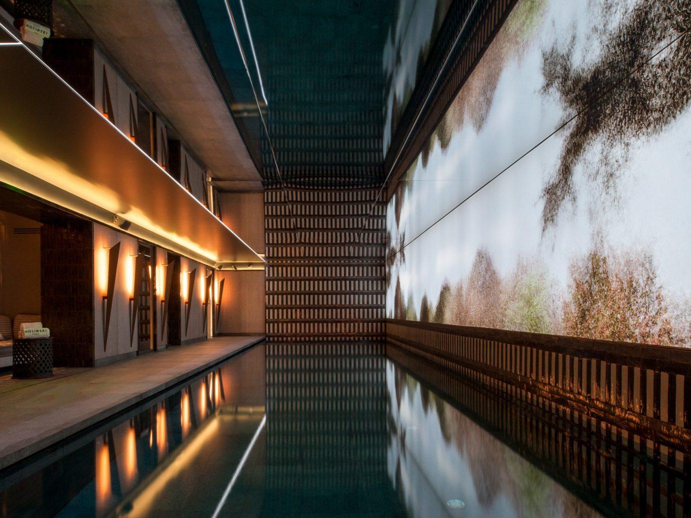 ambient lighting decor Elegant extravagant fancy indoor pool interior Luxury Pool reflection regal sophisticated Style + Design Trip Ideas urban area light Architecture interior design walkway