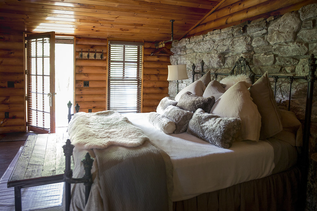 Boutique Hotels Fall Travel Hotels Outdoors + Adventure sofa indoor room floor Bedroom home ceiling bed interior design house window wood log cabin furniture real estate pillow estate bed frame living room