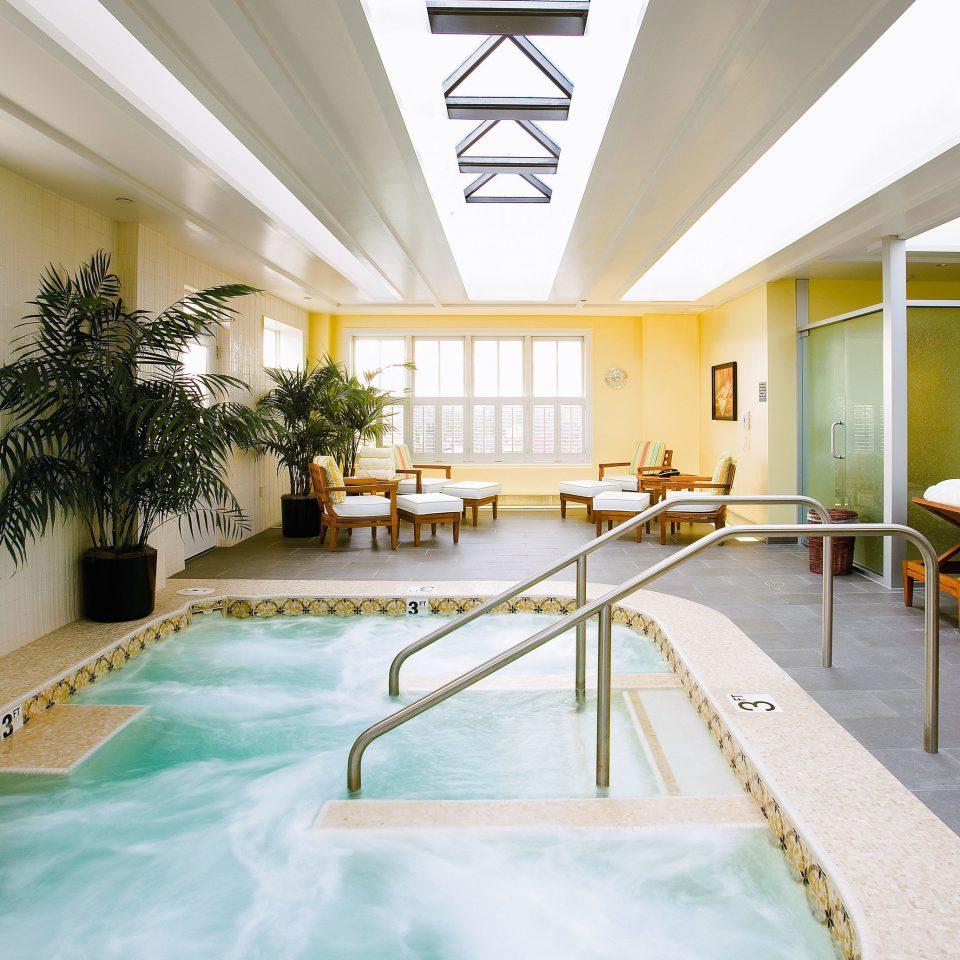 Health + Wellness Hotels Luxury Travel swimming pool building leisure leisure centre condominium yellow home Resort daylighting amenity