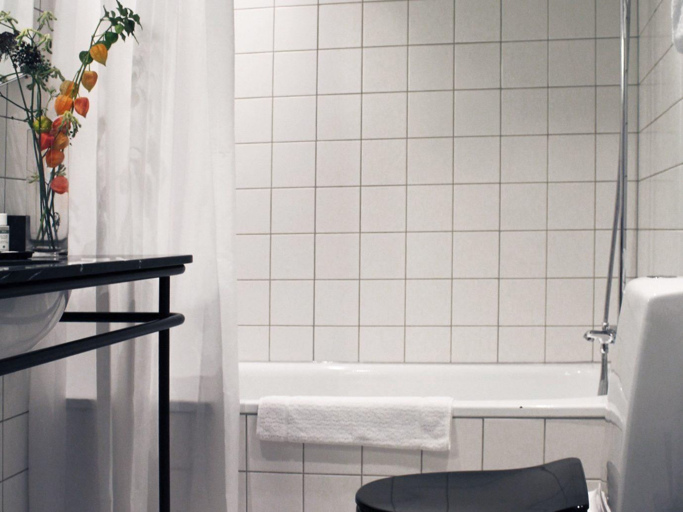 Boutique Hotels Copenhagen Denmark Hotels indoor wall bathroom room tile floor interior design plumbing fixture flooring toilet product design window angle sink product tiled tub Bath