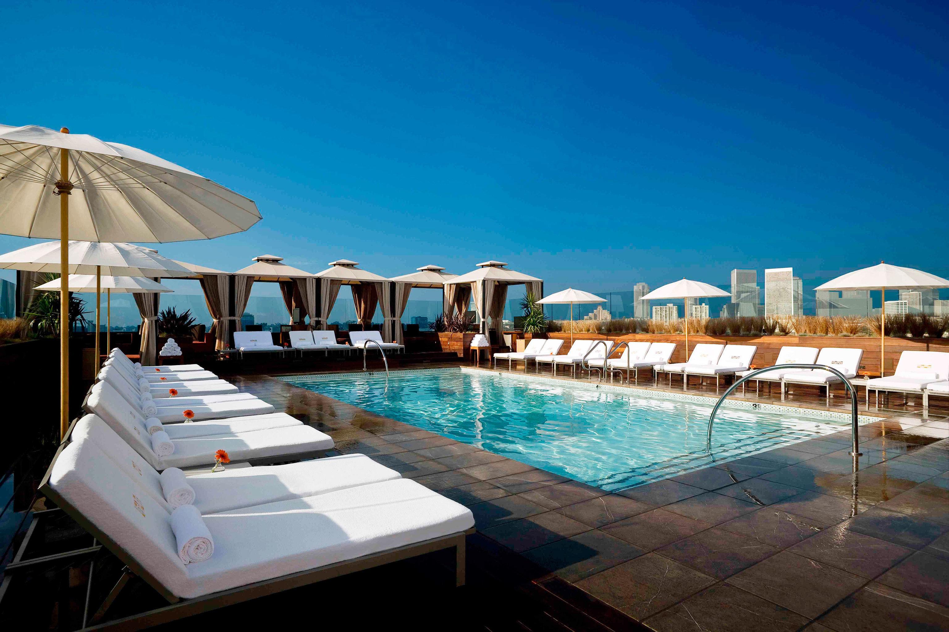 Hip Hotels Modern Nightlife Party Pool Rooftop umbrella chair leisure swimming pool property Resort marina dock Villa caribbean swimming