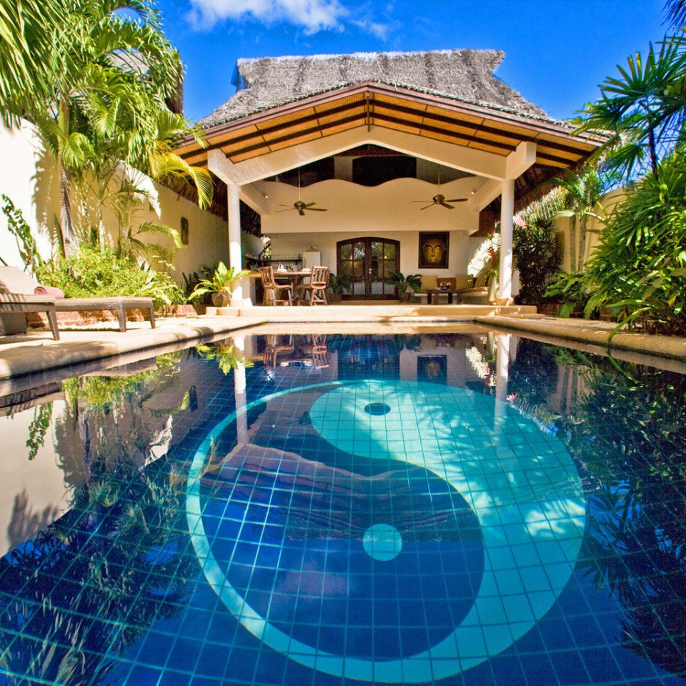 Hip Island Lounge Patio Pool Tropical tree swimming pool leisure property Resort mansion resort town condominium Villa