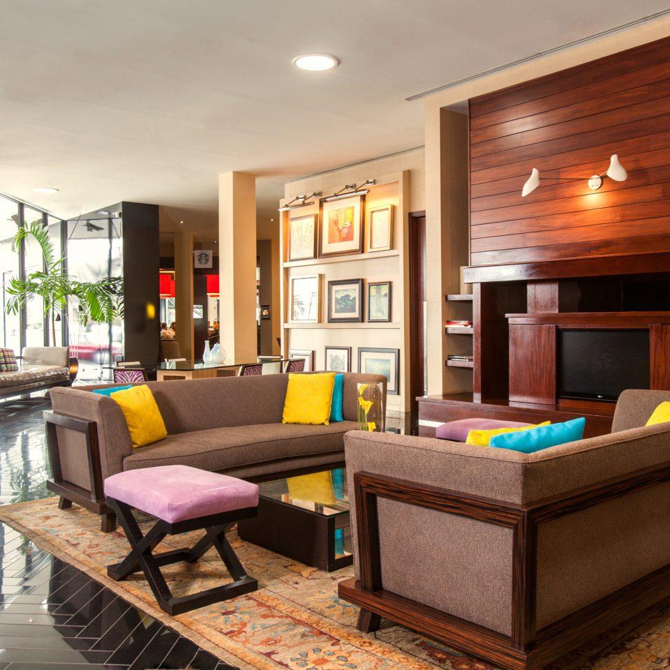 Hip Lobby Lounge living room property home hardwood recreation room condominium flat