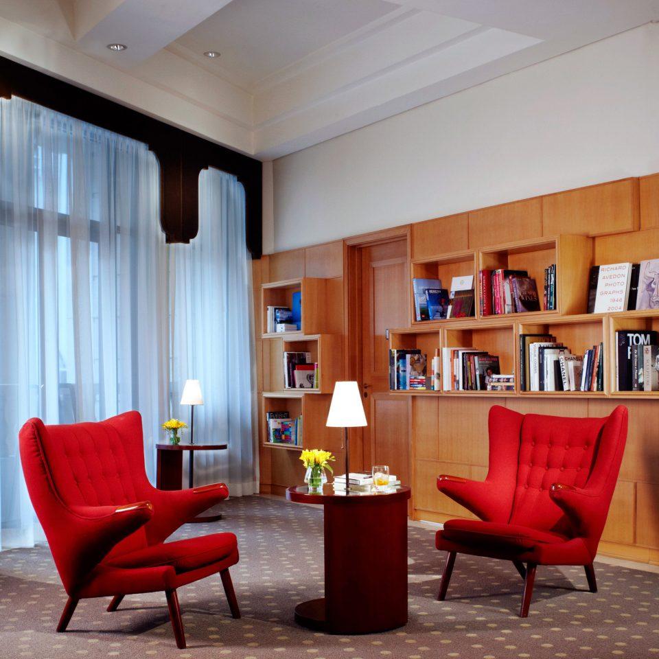 Hip Lounge Luxury Modern red chair living room property home Lobby condominium