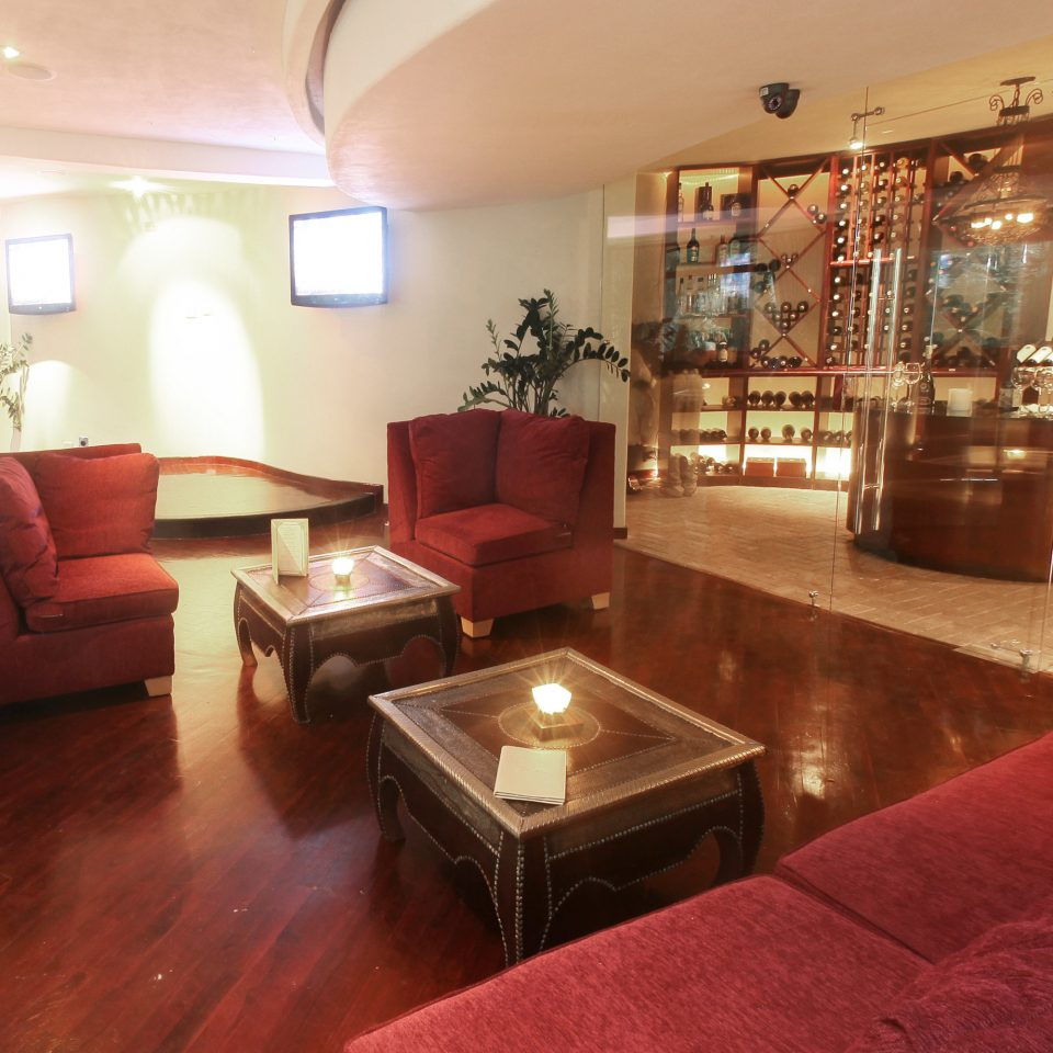 Hip Lounge Luxury Romantic property red Lobby living room Suite condominium
