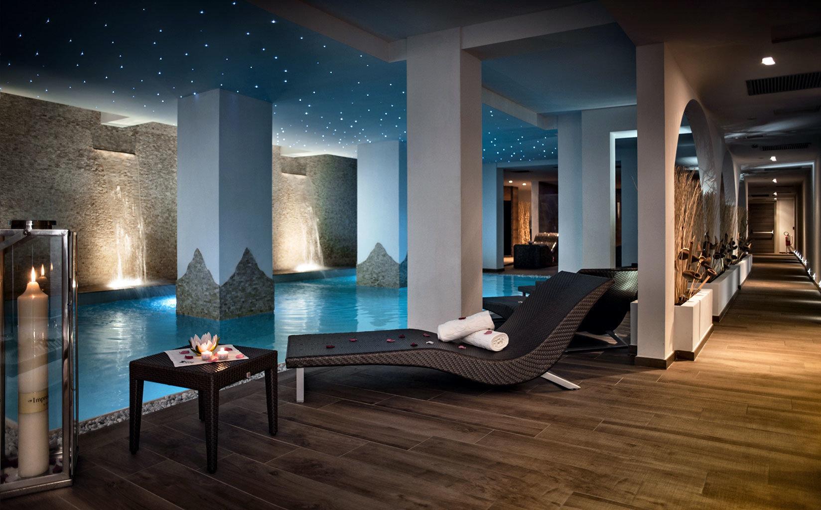 Hip Luxury Pool Spa Wellness property Lobby swimming pool living room lighting flooring mansion