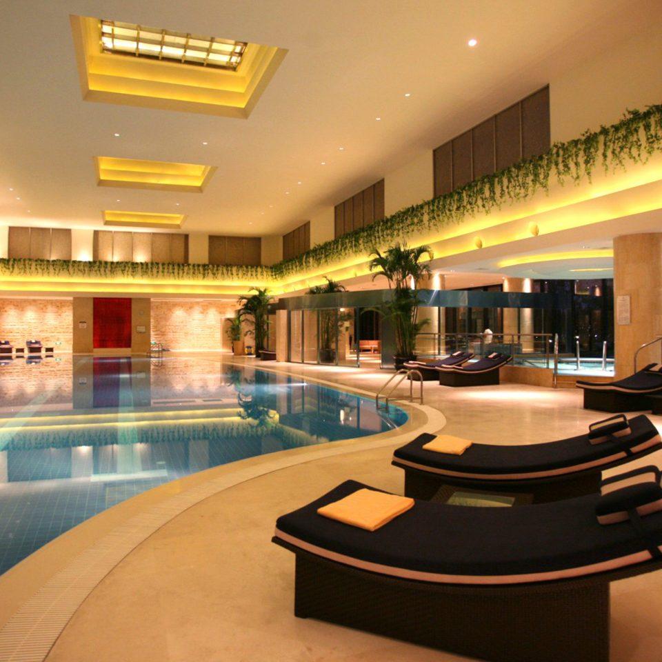 Hip Luxury Pool Scenic views swimming pool property Lobby Resort condominium home recreation room mansion