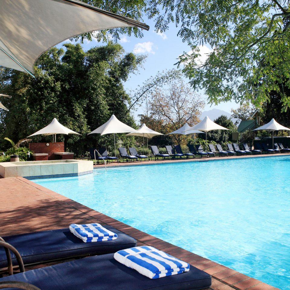 Hip Lounge Luxury Modern Pool tree water swimming pool leisure property Resort Villa backyard empty surrounded