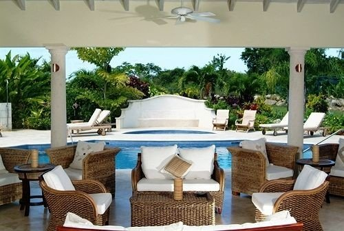 Hip Lounge Luxury chair property Villa Resort outdoor structure backyard home hacienda condominium Patio swimming pool set