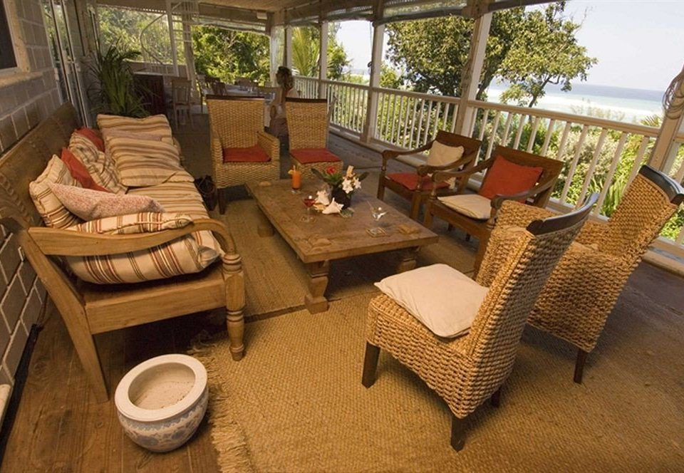 Hip Lounge Luxury Tropical property living room cottage home Villa Resort outdoor structure porch backyard