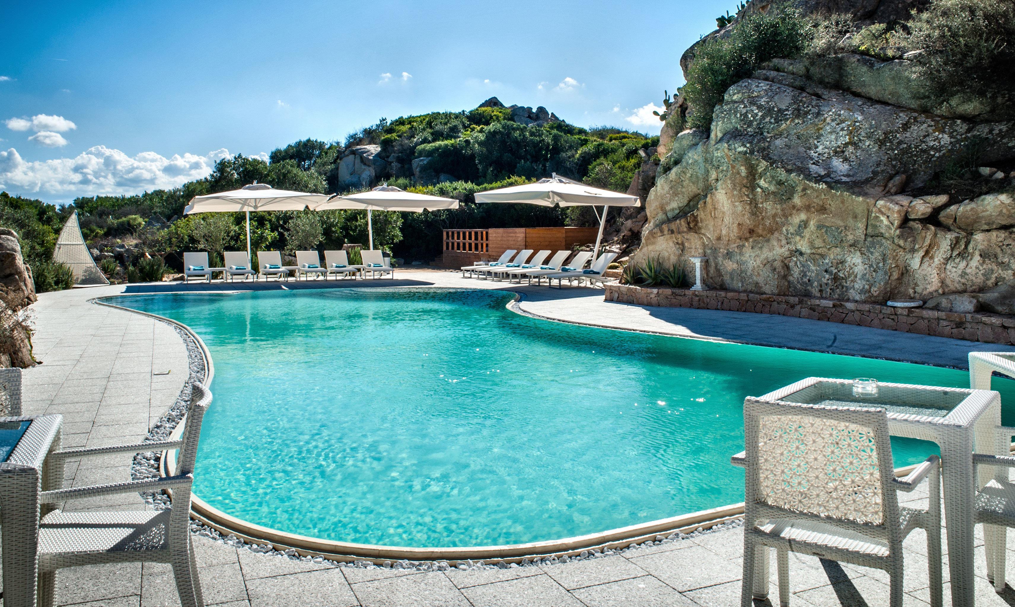 Hip Luxury Pool swimming pool property Villa Resort backyard blue mansion stone swimming