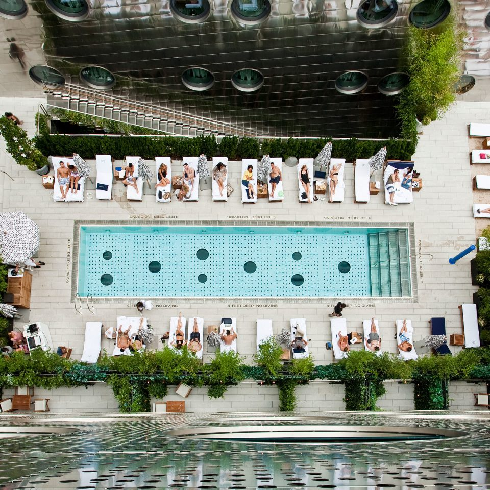 Hip Modern Offbeat Patio Pool Rooftop Resort palace plaza town square water feature fountain
