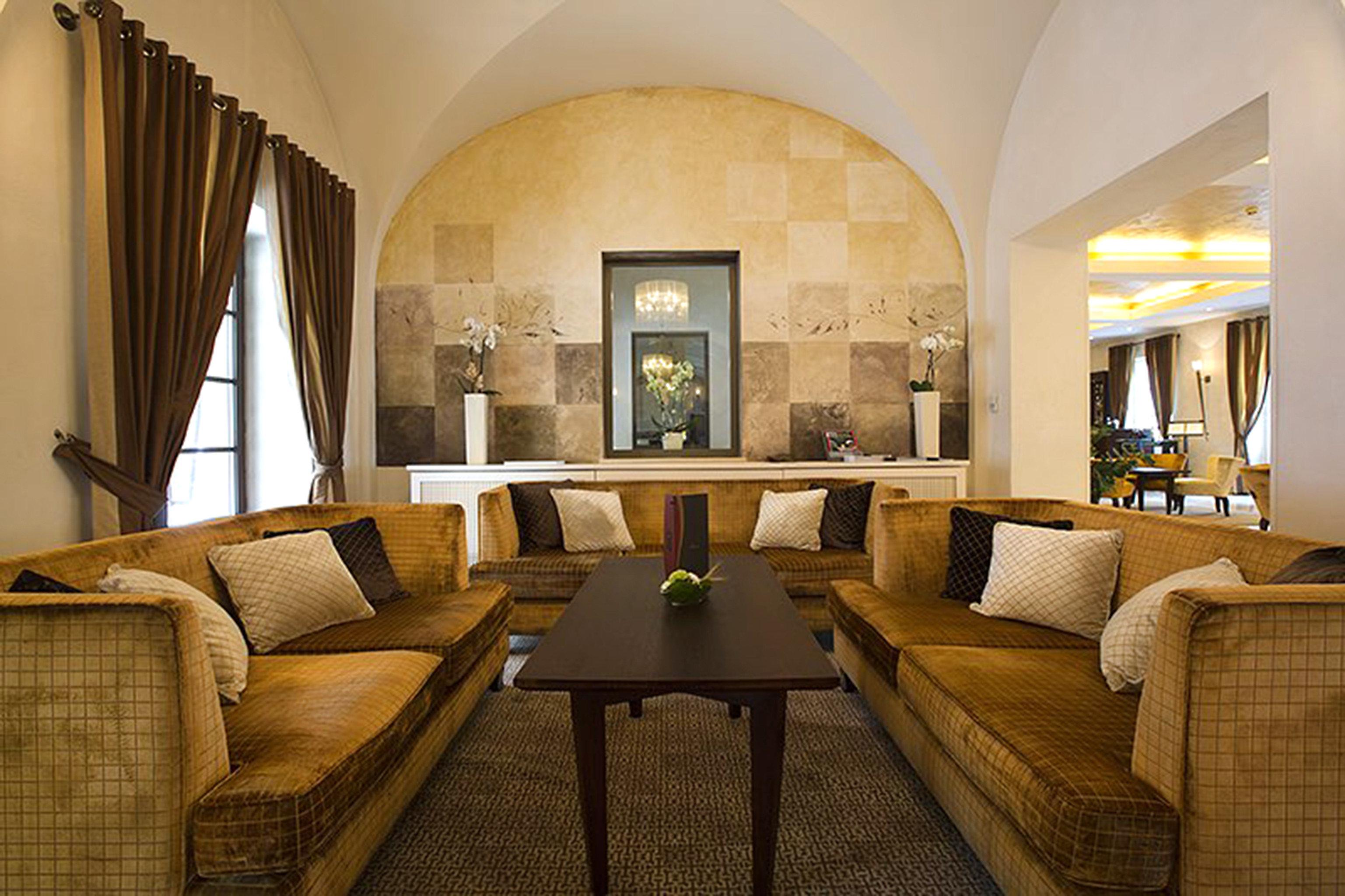 Historic Lobby Lounge chair property living room Suite home condominium mansion Villa tan