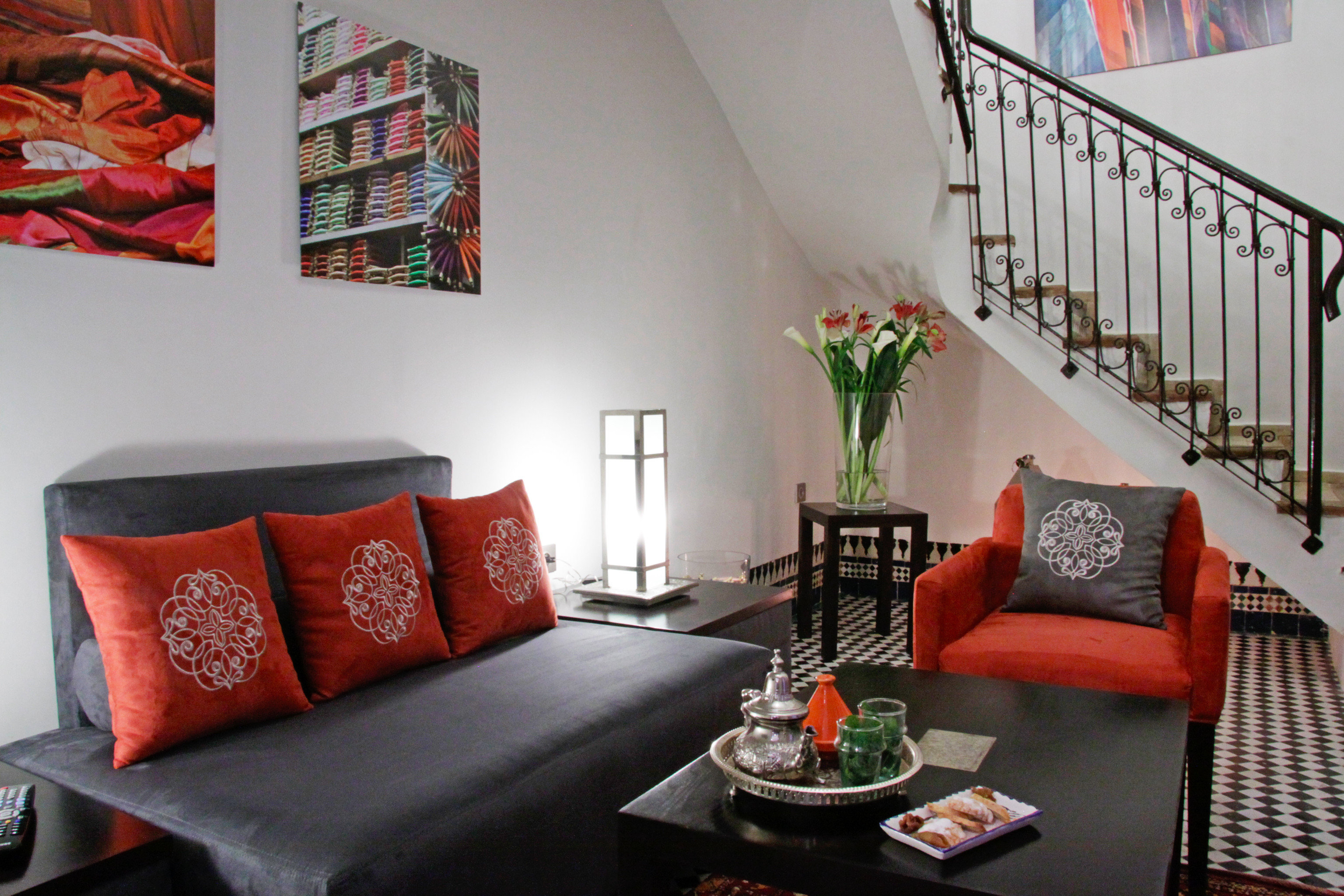 Historic Luxury Modern Resort Suite living room property red home house cottage orange leather